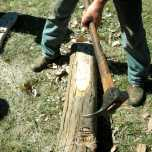 Shaping posts with an Adz