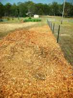 Wood chip fence line
