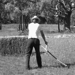 Cutting grass with Scythe